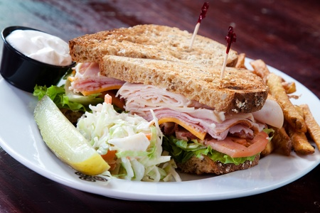 Smoked turkey, smoked ham, smoked bacon, swiss cheese, cheddar cheese, lettuce, tomato, onion, mayo served on a toasted multigrain bread.
