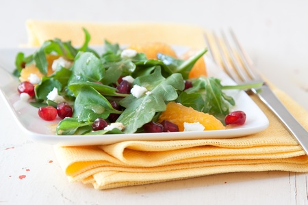 'baby spinach': Summer salad of baby spinach, pomegranate and oranges topped with crumbled feta cheese.