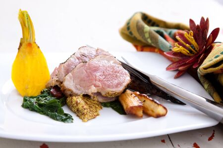 thinly: Sumptuous dinner of thinly sliced pork served with wilted spinach and roasted parsnips. Dijon mustard completes the flavors.