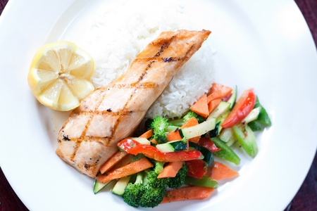 salmon dinner: Fillet of salmon baked with our maple glaze, served on a bed of aromatic basmati rice with stir fry vegetables.