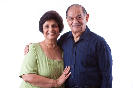 Portrait of a happy elderly East Indian couple 스톡 콘텐츠