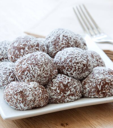 Vegan version of chocolate balls - cashews - topped with grated coconut Foto de archivo