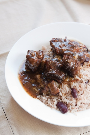 caribbean food: Caribbean style curried Oxtail served with rice mixed with red kidney beans  Shallow DOF