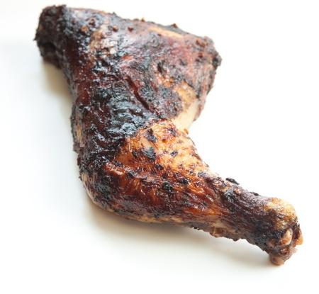 jerk: Barbecued chicken leg also known as Jerk Chicken - Caribbean style  Shallow DOF