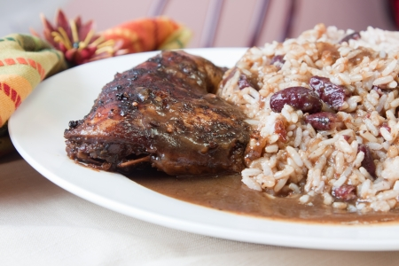 jerk: Caribbean style jerk chicken served with rice mixed with red kidney beans  Shallow Focus on the chicken