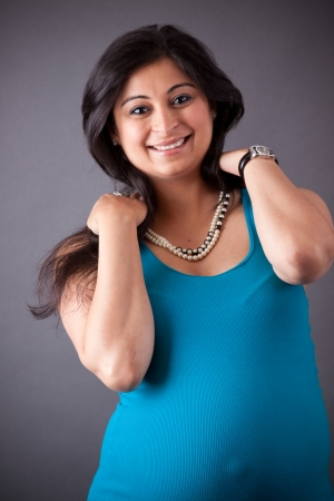 Portrait of a smiling, pregnant East Indian woman  photo