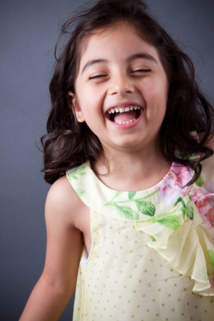 east indians: Portrait of a beautiful Indian girl laughing uncontrollably Stock Photo