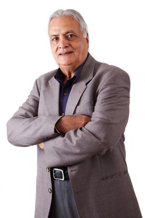 Portrait of a happy elderly East Indian businessman photo