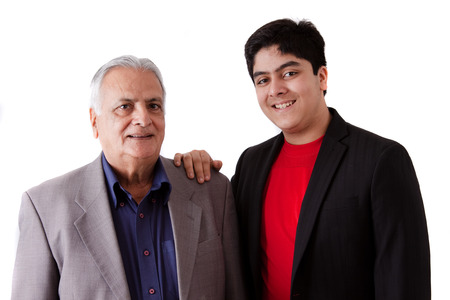 Isolated portrait of a teenage boy with his grandfather - East Indian