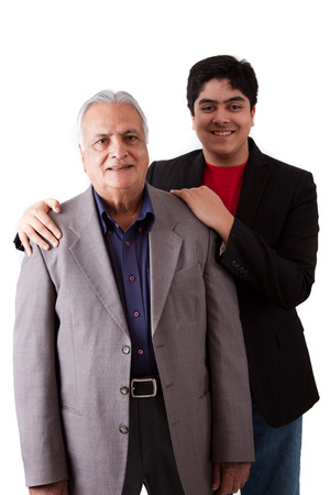 Isolated portrait of a teenage boy with his grandfather - East Indian photo