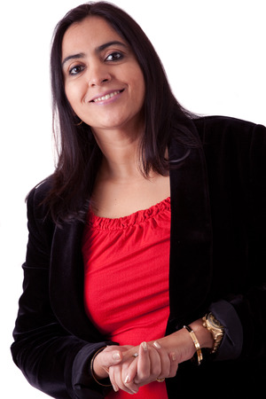 Portrait of an East Indian woman in a business attire against a white backdrop Stock Photo