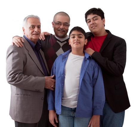 An extended Indian family of grandfather, son and grandsons in a studio setting Stok Fotoğraf