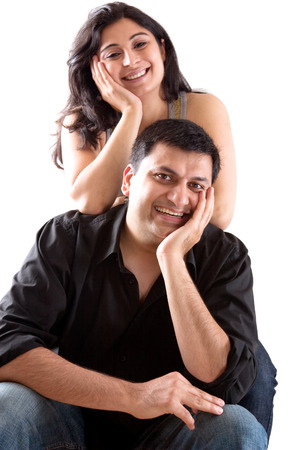 An East Indian man embraces his pregnant wife Stock Photo