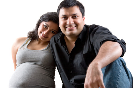 Image of an East Indian man with his pregnant wife Foto de archivo