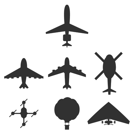 Set di icone di aeroplano, elicottero, drone, mongolfiera e deltaplano. Vista superiore della siluetta nera di vettore isolata su una priorità bassa bianca.