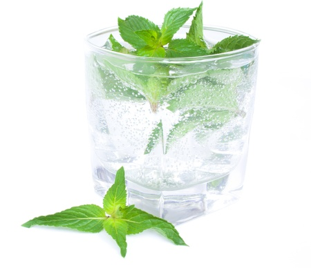 Glass of a cocktail from mint  isolated on the white background