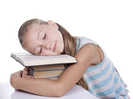tired girl slept on the books