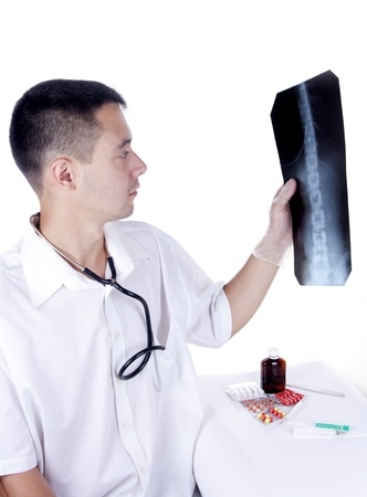 The doctor looks a x-ray picture