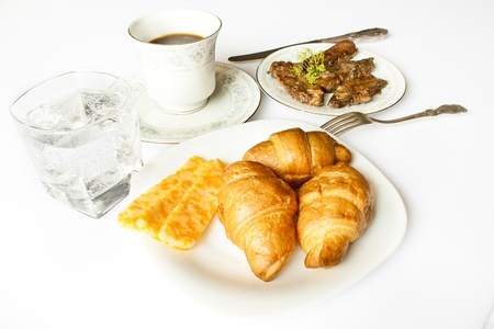Tasty breakfast of coffee with croissant
