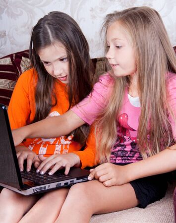 Children are engaged at the computer in homework