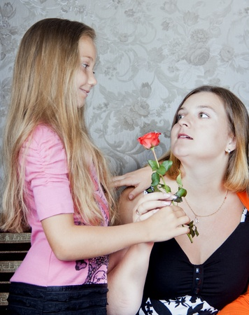 Daughter gives mother a flower Stock Photo