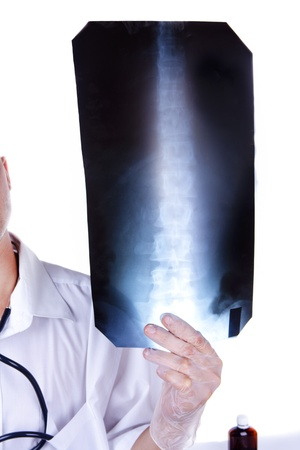 The doctor looks a x-ray picture Stock Photo - 10648467