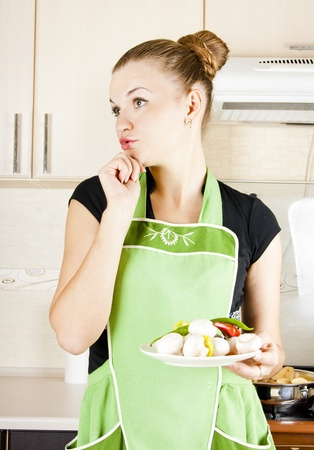 young woman cooks dinner in the kitchen Stock Photo - 10644056