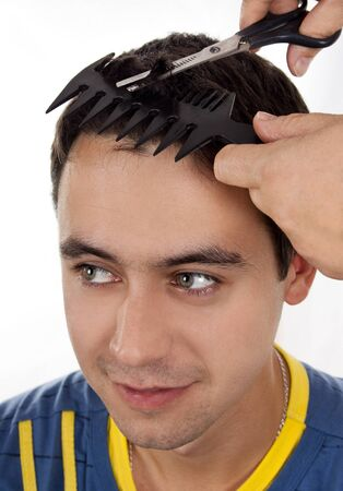 A young man hair cut at the hairdresser photo
