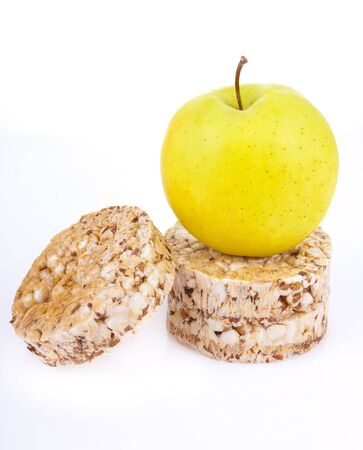 dietetic loaves from bran and germ of wheat with green apple Stock Photo - 11049255