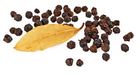 black pepper and bay leaf isolated on the white background