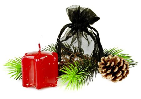 Pine twig with red Christmas candles and gift