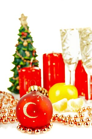 Christmas toys and Christmas tree with candles Stock Photo