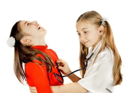 girl friends played be a doctor Stock Photo