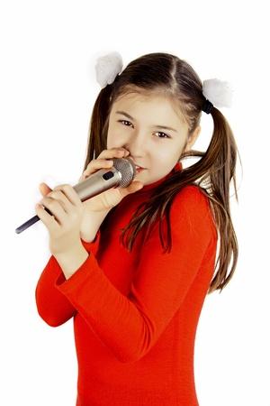 idols: Beautiful girl singing into a microphone Stock Photo
