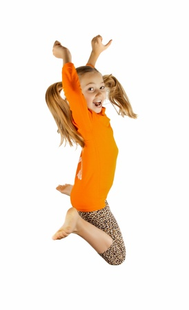 a happy little girl jumps and plays Stock Photo