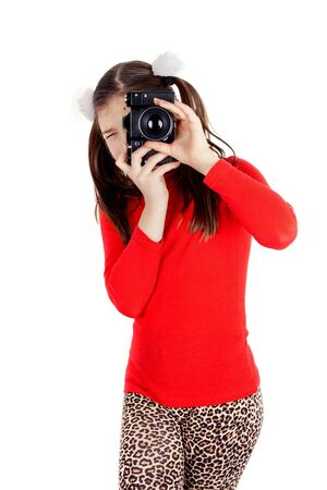 shootting: a happy little girl photographs Stock Photo