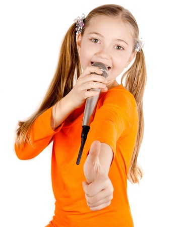 Beautiful girl singing into a microphone Stock Photo