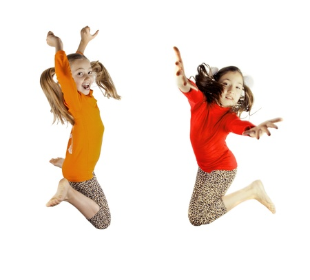dancing pose: two little girls played and jumping Stock Photo