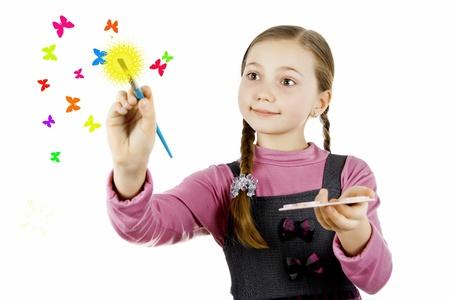 Little Schoolgirl draws butterflies and the sun Stock Photo