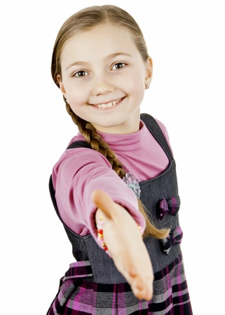 Little school girl reaches out to say hello Stock Photo