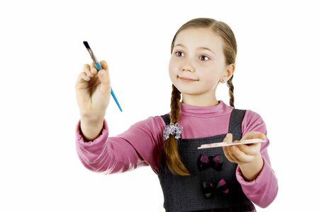 Little Schoolgirl draws  photo