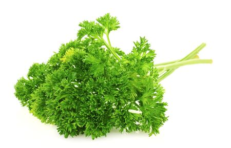 fresh bunch of parsley isolated on white Stock Photo