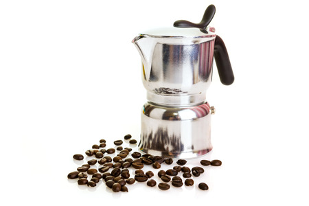 Metal coffeepot with beans on a white background photo