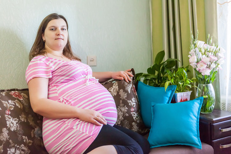Pregnat woman resting at home