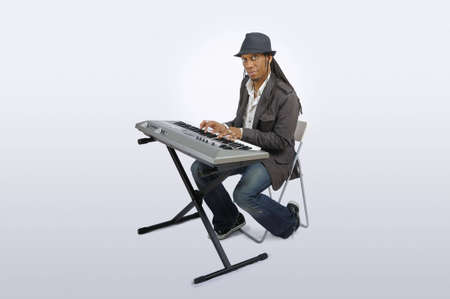 Musician seated at electronic keyboard