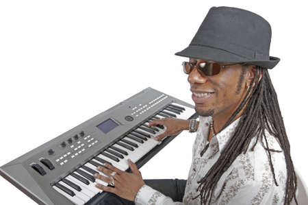 African American man playing electronic keyboard with all the keys visible.