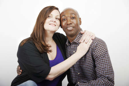 mixed marriage: Husband and wife seated together Stock Photo