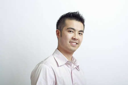 Young Asian man with spiky hair at a three quartes view Stock Photo
