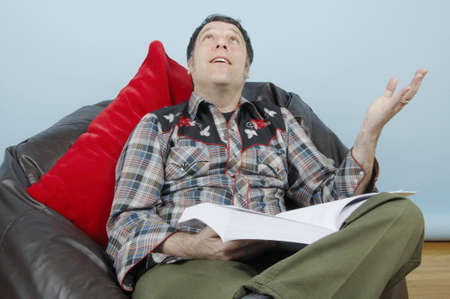 A man overwhelmed by all the information he needs to absorb.
