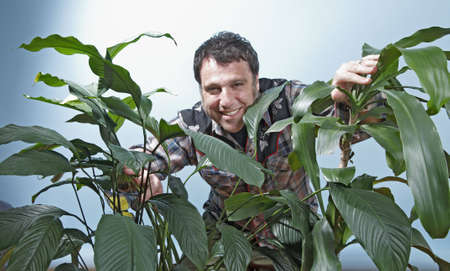 A man at home with his plants